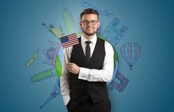 Elegant man with sightseeing concept and flag. Elegant man with sightseeing concept on the background  and flag on his hand Stock Images