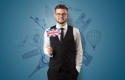 Elegant man with sightseeing concept and flag. Elegant man with sightseeing concept on the background  and flag on his hand Stock Photography