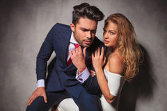 Elegant man sitting on his woman's lap and looks away Royalty Free Stock Photography
