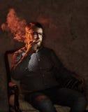 Elegant man smokes a pipe. Studio shot. Stock Photo