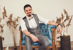 Elegant man in suit with bow tie Royalty Free Stock Photos