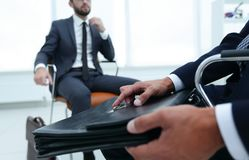 Elegant man in suit with briefcase stock photo