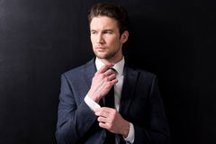 Elegant man in suit is posing pensively Stock Images