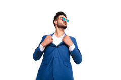 Elegant man in sunglasses pulling his collar like superman Royalty Free Stock Photos