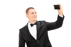 Elegant man taking a selfie with cell phone Stock Photos