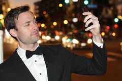Elegant man taking a selfie frowning with duck lips.  royalty free stock images