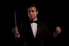 Elegant man in tuxedo conducting Royalty Free Stock Images