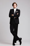 Elegant man in tuxedo full body shot Stock Image