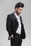 Elegant man in tuxedo holding his hands in pocket Royalty Free Stock Photography