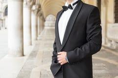 Elegant man in tuxedo stock images