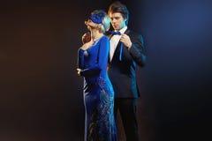 Elegant man tying the blue mask Royalty Free Stock Photography