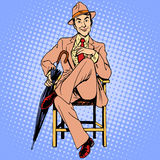 Elegant man with an umbrella sitting on the stool Royalty Free Stock Photography