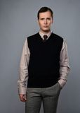 Elegant man. Man in vest isolated on grey background stock photography