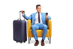 Elegant man waiting departure seated on armchair Royalty Free Stock Images