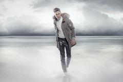 Elegant man walking on the frozen lake Stock Image