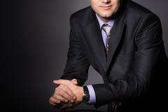 Elegant man wearing fashion suit. Stock Images