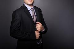 Elegant man wearing fashion suit. Businessman in Stock Photo