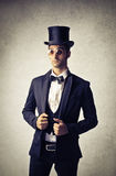 Elegant man. Man wearing vintage clothes and a hat stock images