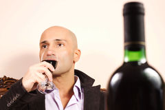 Elegant man with wine glass Stock Image