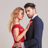 Elegant man and woman holding each other. Stock Image