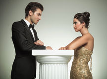 Elegant man and woman  look at each other Royalty Free Stock Photography