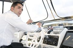 Elegant man at yatch control turnedo Stock Image