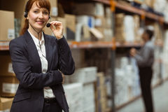 Elegant manager talking into a headset Stock Image