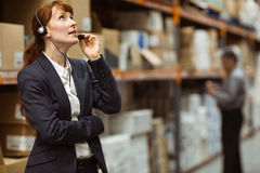 Elegant manager talking into a headset Stock Photos