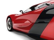 Elegant maroon sports car - side closeup shot. Isolated on white background Stock Photos