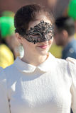 Elegant masked young woman dressed in white and black during the Carnival of Venice Royalty Free Stock Images
