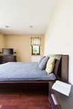 Elegant master bedroom with double bed Stock Images