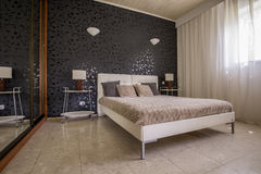 Elegant master bedroom with mirror Stock Image