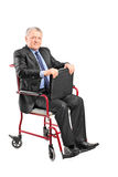 Elegant mature businessman sitting in wheelchair Royalty Free Stock Photos