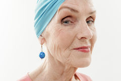 Elegant mature lady wearing stylish turban Royalty Free Stock Photography
