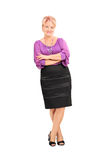 Elegant mature woman leaning against a wall Royalty Free Stock Photo