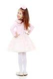 Elegant meisje in een roze kleding royalty-vrije stock foto's