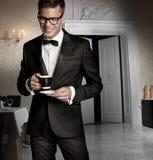 Elegant men. Photo of elegant man drinking coffe Royalty Free Stock Photo