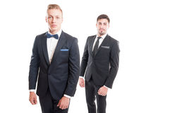 Elegant men wearing suits, necktie and bowtie. Isolated on white background Royalty Free Stock Photo