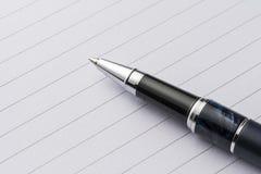 Elegant metal pen on a sheet of paper Royalty Free Stock Photos