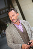 Elegant middle-aged man standing in street Royalty Free Stock Images