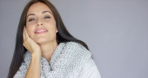 Elegant middle aged woman posing with woolen warm scarf. Elegant beautiful middle aged woman posing with woolen warm scarf around her neck. She smiling and stock video footage