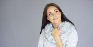 Elegant middle aged woman posing with woolen warm scarf Stock Photography