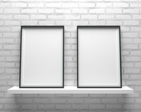 Elegant and minimalistic two picture frames standing on gray wal stock image