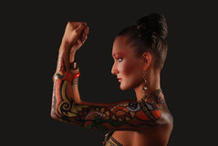 Elegant model with bright makeup and body art. Stock Photo
