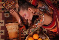 Elegant model with bright makeup and body art. Royalty Free Stock Photo