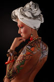 Elegant model with bright makeup and body art. Royalty Free Stock Images