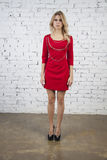 Elegant model poses  in red short dress Royalty Free Stock Photography