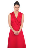 Elegant model in red dress sticking her tongue out Royalty Free Stock Image