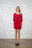 Elegant model in red party dress stock images