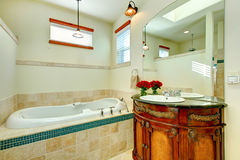 Elegant modern bathroom with an antique wooden storage cabinet Royalty Free Stock Photos